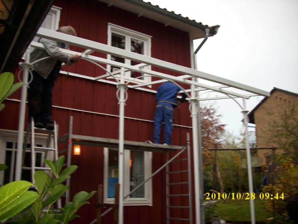 Vordach Terrassenüberdachung an einem Holzhaus
